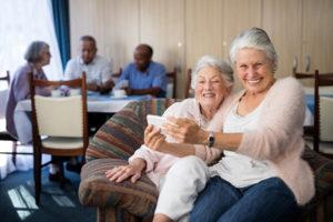 two seniors enjoy senior living community amenities Lake Worth fl